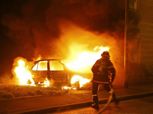 A fireman tries to extinguish a car set ablaze by demonstrators protesting over right-wing (UMP) candidate Nicolas Sarkozy's triumph in presidential elections, 07 May 2007 in the French northern city of Lille. Youths clashed with police in French cities for the second night running 07 May as they staged violent protests over rightwinger Nicolas Sarkozy's triumph in presidential elections. Some 500 people went on a rampage in the Bastille area of eastern Paris, toppling motorbikes and smashing the windows of shops and telephone cabins. Riot police charges eventually forced the crowd to disperse. Pursuits of small gangs continued into the night.    AFP PHOTO PHILIPPE HUGUEN (Photo credit should read PHILIPPE HUGUEN/AFP/Getty Images)